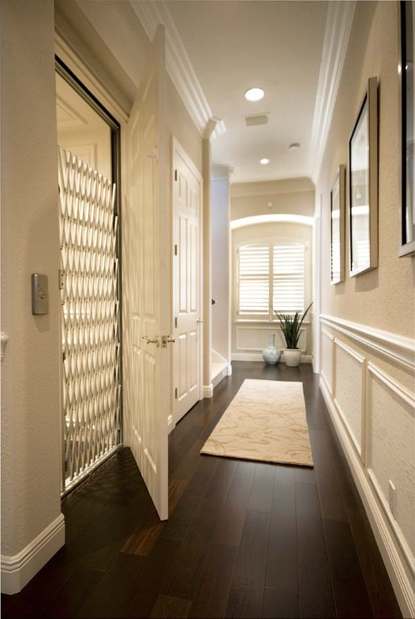 hallway with a home elevator